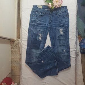 Machine Nouvelle Mode Distressed Jeans